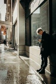 stranger outside of a capital one.